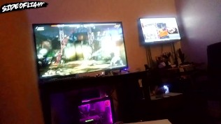Fit white guy has sex with gamer girl sitting on lap while girl plays Mortal Kombat with male guest